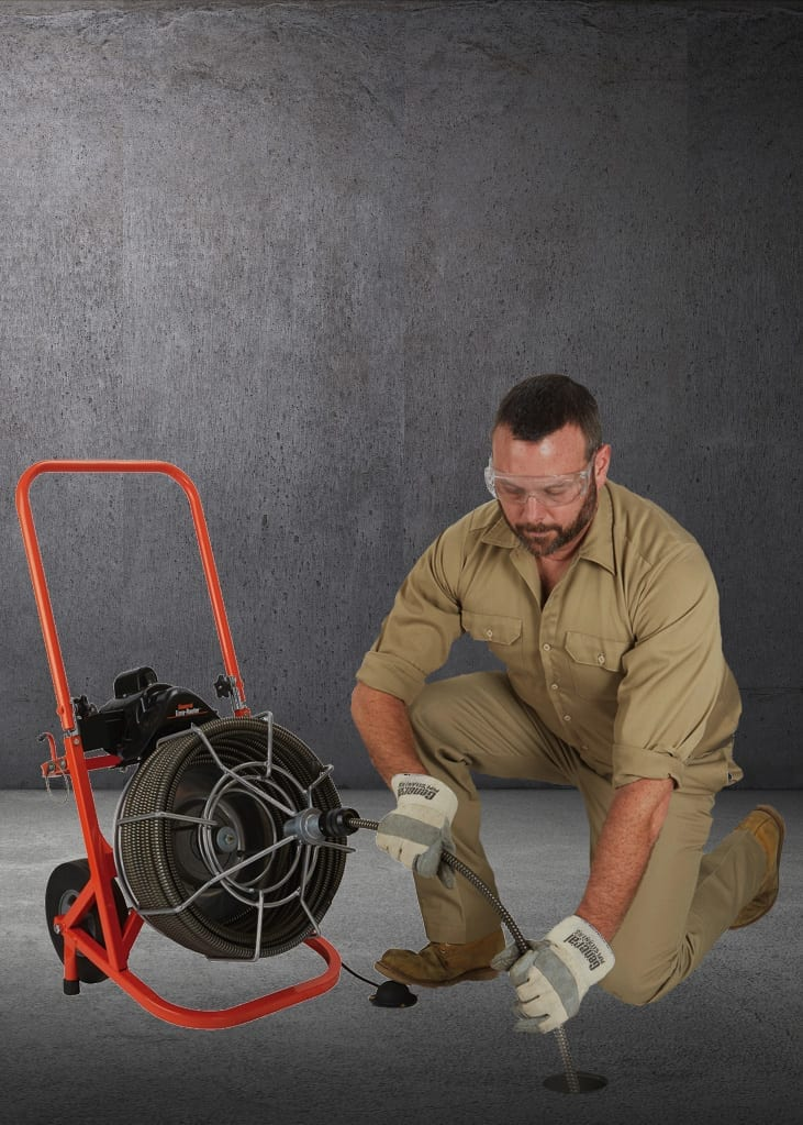 Plumber with Rooter Tool